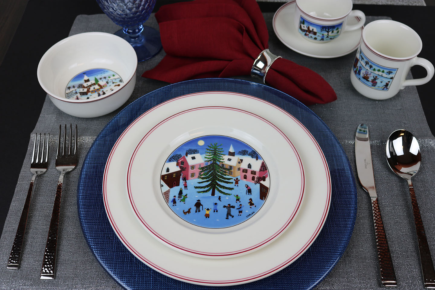 Design Naif Christmas dinnerware with blue Verona charger